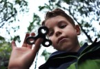 "Eight-year-old Tom Wuestenberg plays with a fidget spinner in a park in New York on May 23, 2017.  It was supposed to calm nerves, relieve stress and improve concentration but the new-anti fidget toy spreading fast through US and European schools is whipping up anger among teachers on both sides of the Atlantic. Just months after the ""fidget spinner"" first whirled its way into the hands of antsy youngsters, some schools have already banned it -- sparking a debate about difficulties children experience concentrating.  / AFP PHOTO / Jewel SAMAD / TO GO WITH AFP STORY by Catherine TRIOMPHE, US education toys trend social        (Photo credit should read JEWEL SAMAD/AFP/Getty Images)"